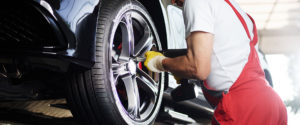 Man Fixing Car Tire