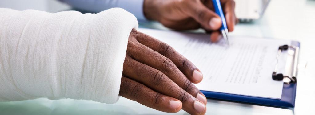 Blog Injured Man Filling Insurance Claim Form